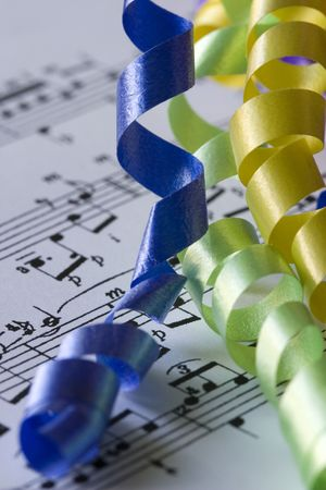 three curly birthday ribbons and music notes