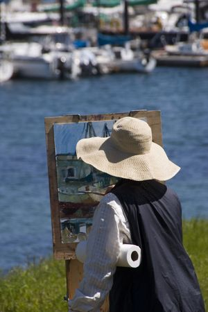 woman painting by the Monterey waterfront
