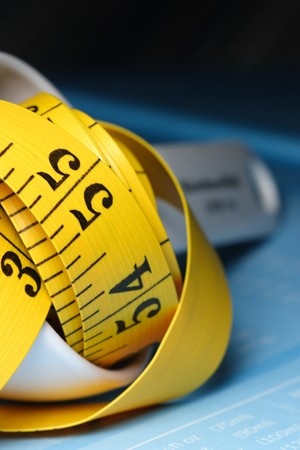 measuring spoon: yellow measuring tape and measuring spoon  Stock Photo