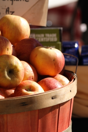 seller: delicious red apples from the local growers for sale at the Sunday market Stock Photo