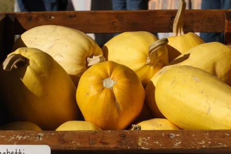 sunday market: yellow squashes in a wooden cart at the Sunday market Stock Photo