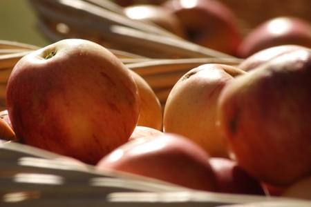 Fresh golden apples in a basket  photo