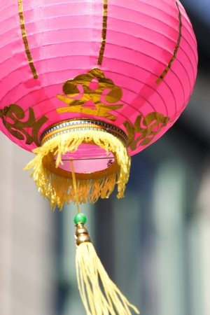 Pink paper lantern blowing in the wind photo
