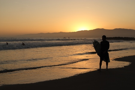 Sihouette of a surfer at sunset photo