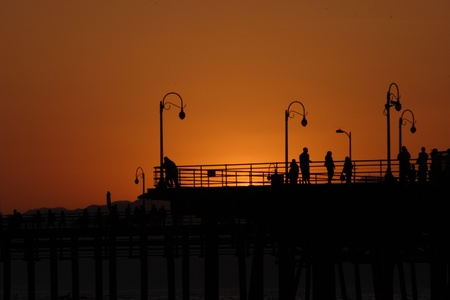 Silhouette of Santa Monica boardwalk at sunset photo