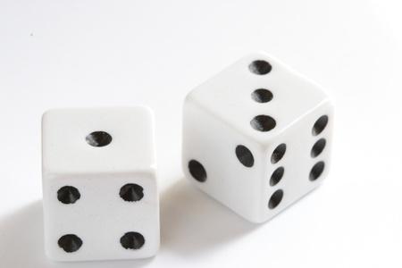 crap: pair of black and white casino dice