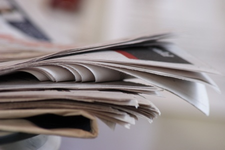 articles: Sunday newspapers on kitchen table