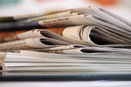 travel features: stack of morning newspapers Stock Photo