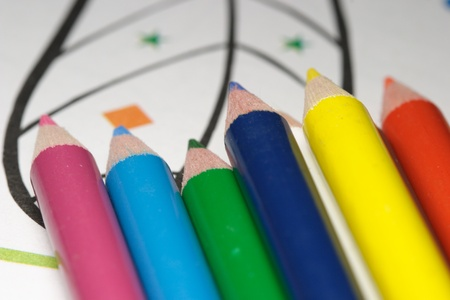 color pencils and childs drawing workbook photo