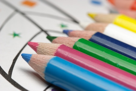 colorful pencils and childrens coloring book photo