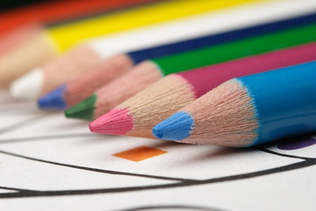pretty coloring pencils on a childs coloring book photo