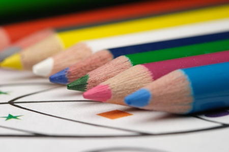 Pretty color pencils and childs coloring book photo