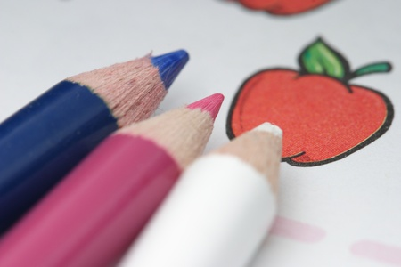 three color pencils and childs activity book photo