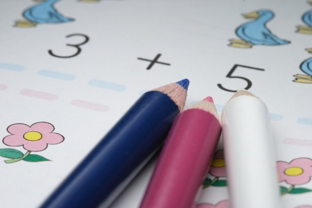 color pencils and childrens addition workbook photo