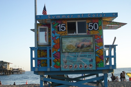 Colorful summer life guard tower on the beach Editorial