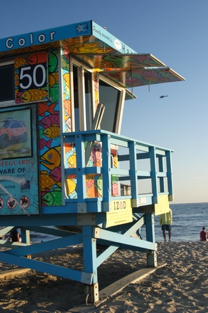 close up view of a colorful summer life guard tower on the beach