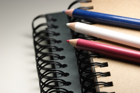 Two sketchbooks and three color pencils photo