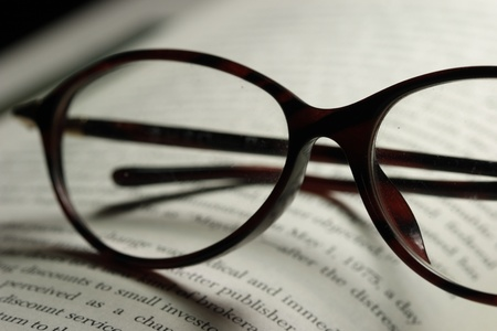 pair of eyeglasses and a novel photo