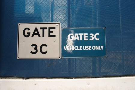 Gate signs on a blue fencing surrounding Ground Zero