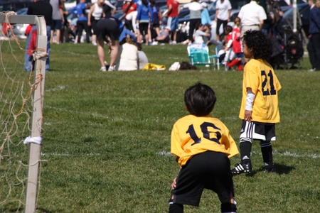 two young soccer stars in training
