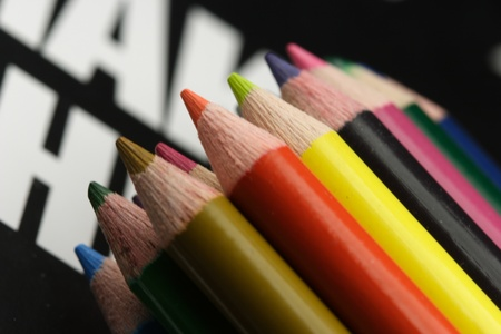 color pencils and textbook Stock Photo - 10564093
