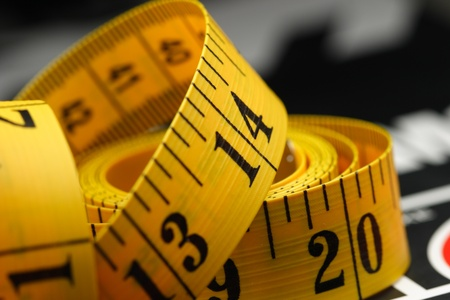 measuring scale: yellow tape measure on a book