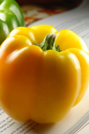 yellow bell pepper on a book photo
