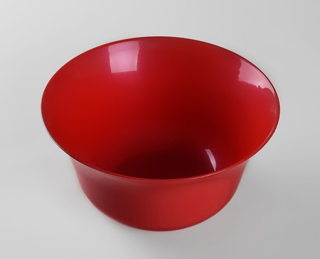 Red plastic deep dish isolated on white background