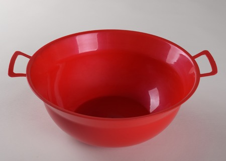 rimless: Red deep plastic bowl with handles isolated on white background Stock Photo