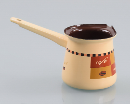 Enameled pot with handle for making turkish coffee Stock Photo