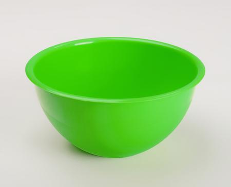 Green plastic deep dish isolated on wjite background Stock Photo