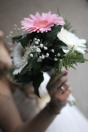 gloved: Wedding bouquet in brides hands.