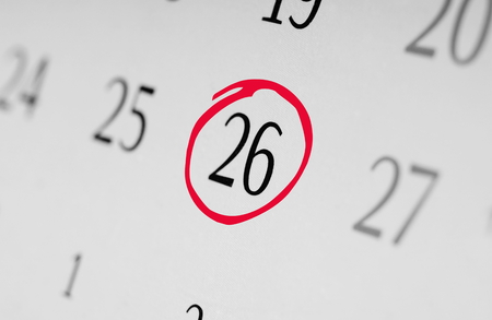 Mark the date number 26, focus point on the red marked number. Stock Photo