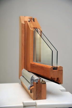 The cut wooden window profile with two glasses