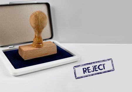 sanctioned: Wooden stamp on a desk REJECT