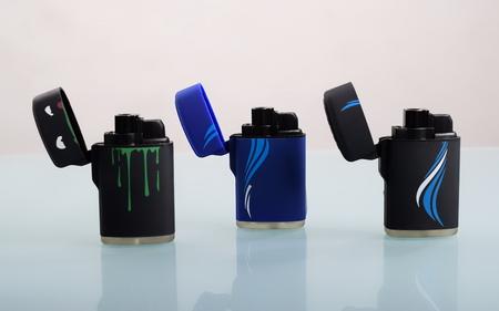 Three cigarette lighters Reklamní fotografie