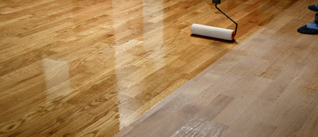 Lacquering wood floors. Worker uses a roller to coating floors. Varnishing lacquering parquet floor by paint roller - second layer. Home renovation parquet Фото со стока - 121735651