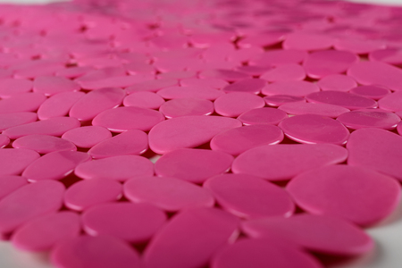 Red rubber mat for bath with pattern as background. Red rubber mat with suction cups and holes anti slip for baby bath