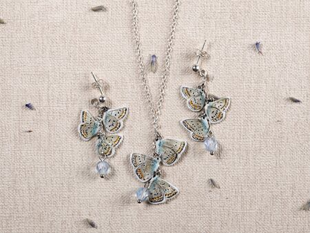 Handmade copper and silver jewelry in the shape of butterfly from the genus Polyommatus amandus. Handmade jewelry