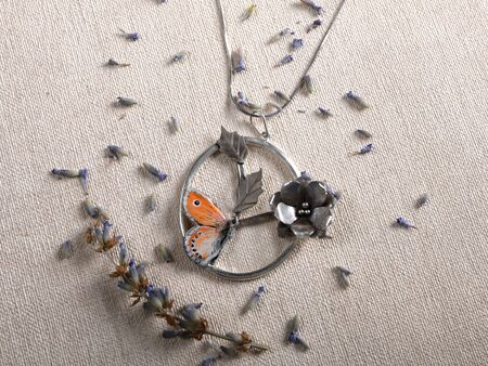 Handmade copper jewelry in the shape of butterfly from the genus Coenonympha leander. Handmade jewelry