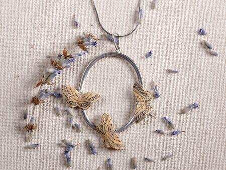 Handmade copper jewelry in the shape of butterfly from the genus Idaea moniliata. Handmade jewelry Reklamní fotografie