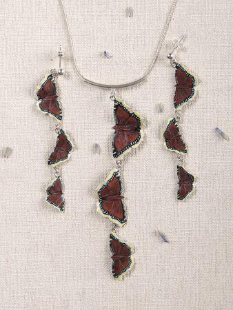 Handmade copper jewelry in the shape of butterfly from the genus Nymphalis antiopa. Handmade jewelry Reklamní fotografie