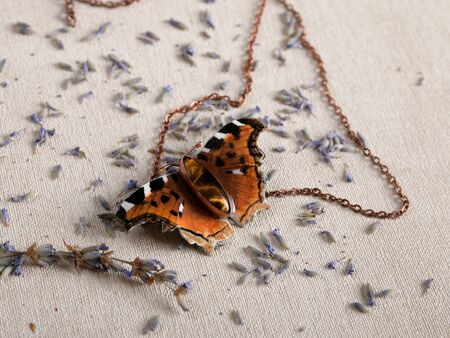 Handmade copper jewelry in the shape of butterfly from the genus Nymphalis vaualbum. Handmade jewelry
