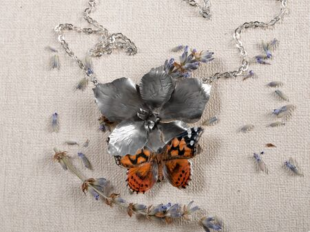 Handmade copper and silver jewelry in the shape of butterfly from the genus Vanessa cardui. Handmade jewelry Reklamní fotografie