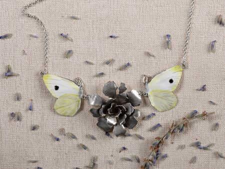 Handmade copper and silver jewelry in the shape of butterfly from the genus Pieris Brasicae. Handmade jewelry