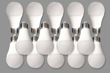 Many led bulb light and energy-saving lamp on table on gray background. Energy saving concept