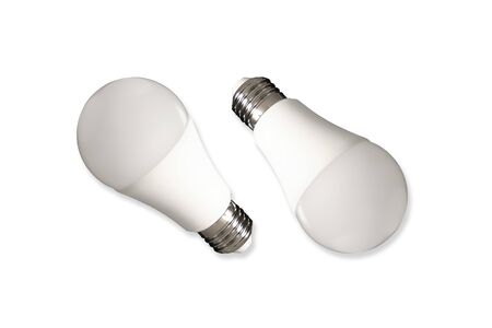 Two led bulb lights and energy-saving lamps on table on white background. Energy saving concept