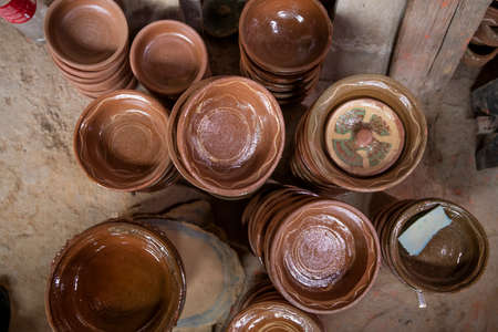 Close-up of earthenware crockery and dishes handmade from varnished baked clay
