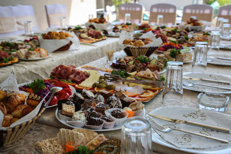 Served table, filled with very tasty and varied food, cutlery. Special wedding concept