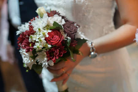 Bride with wedding bouquet in the church. Romantic wedding concept
